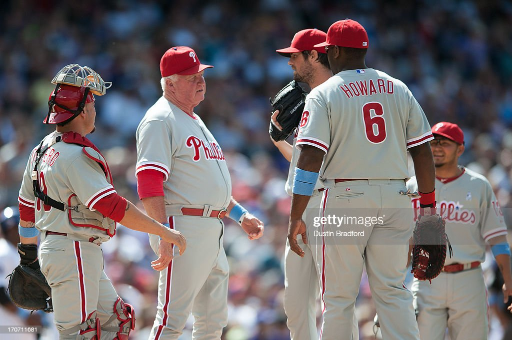 <a gi-track='captionPersonalityLinkClicked' href=/galleries/search?phrase=Charlie+Manuel&family=editorial&specificpeople=217967 ng-click='$event.stopPropagation()'>Charlie Manuel</a> #41, <a gi-track='captionPersonalityLinkClicked' href=/galleries/search?phrase=Humberto+Quintero&family=editorial&specificpeople=226980 ng-click='$event.stopPropagation()'>Humberto Quintero</a> #12, and <a gi-track='captionPersonalityLinkClicked' href=/galleries/search?phrase=Ryan+Howard&family=editorial&specificpeople=551402 ng-click='$event.stopPropagation()'>Ryan Howard</a> #6 of the Philadelphia Phillies visit <a gi-track='captionPersonalityLinkClicked' href=/galleries/search?phrase=Cole+Hamels&family=editorial&specificpeople=565675 ng-click='$event.stopPropagation()'>Cole Hamels</a> #35 during a rough inning against the Colorado Rockies at Coors Field on June 16, 2013 in Denver, Colorado. The Rockies beat the Phillies 5-2.