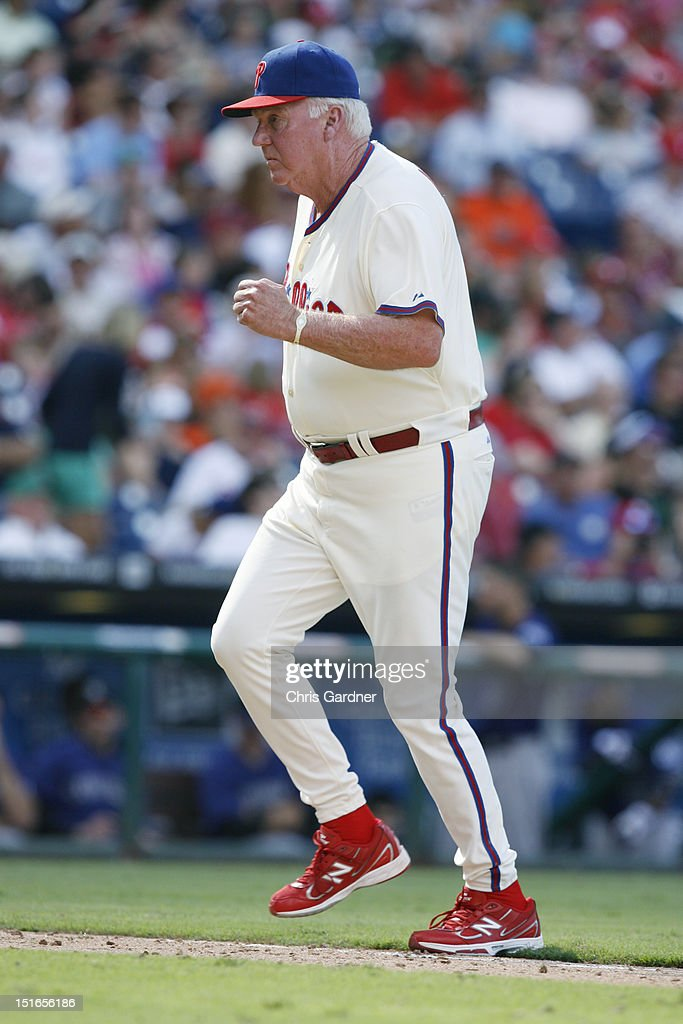 <a gi-track='captionPersonalityLinkClicked' href=/galleries/search?phrase=Charlie+Manuel&family=editorial&specificpeople=217967 ng-click='$event.stopPropagation()'>Charlie Manuel</a> #41 of the Philadelphia Phillies jogs off the field after making a pitching change against the Colorado Rockies at Citizens Bank Park on September 9, 2012 in Philadelphia, Pennsylvania.