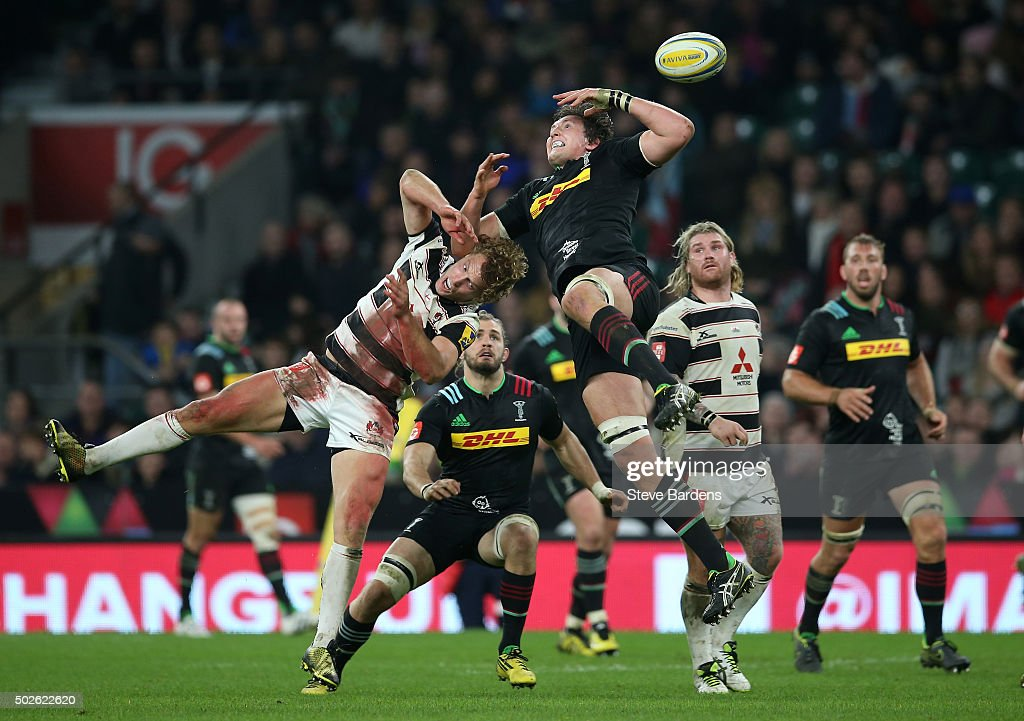 Charlie Matthews of Harlequins jumps for a high ball with Billy Twelvetrees of Gloucester during the Aviva Premiership 'Big Game 8' match between Harlequins and Gloucester at Twickenham Stadium on December 27, 2015 in London, England.