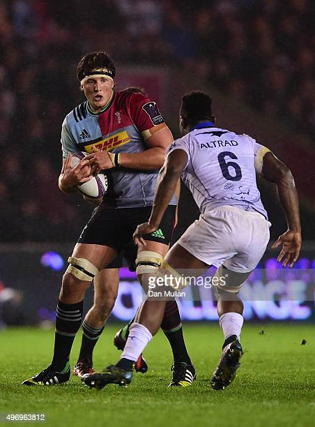 Charlie Matthews of Harlequins takes on Fulgence Ouedraogo of Montpellier during the European Rugby Challenge Cup Pool 3 match between Harlequins and...