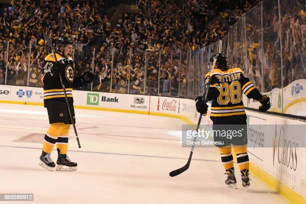 Charlie McAvoy and David Pastrnak of the Boston Bruins celebrate a goal against the Ottawa Senators in Game Three of the Eastern Conference First...