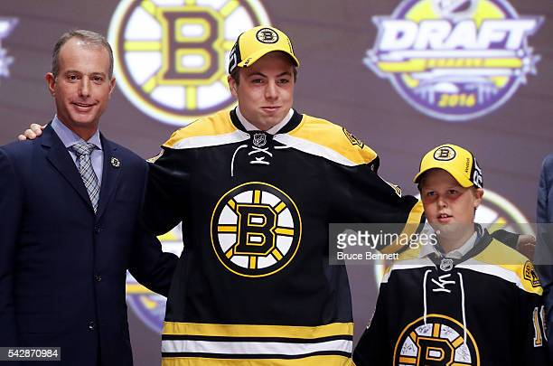Charlie McAvoy celebrates with the Boston Bruins after being selected 14th overall during round one of the 2016 NHL Draft on June 24 2016 in Buffalo...