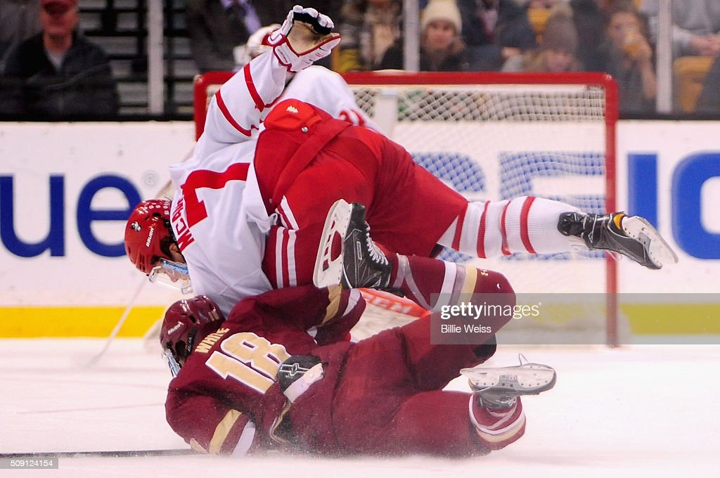 Charlie McAvoy #7 of Boston University trips over <a gi-track='captionPersonalityLinkClicked' href=/galleries/search?phrase=Colin+White+-+Ice+Hockey+Forward&family=editorial&specificpeople=14022797 ng-click='$event.stopPropagation()'>Colin White</a> #18 during the first period of the Beanpot Tournament championship game at TD Garden on February 8, 2016 in Boston, Massachusetts.