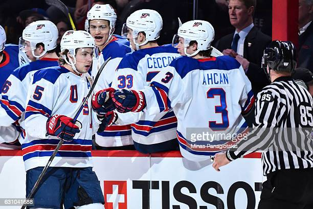 Charlie McAvoy of Team United States celebrates a second period goal with teammates on the bench during the 2017 IIHF World Junior Championship gold...
