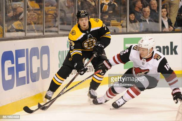 Charlie McAvoy of the Boston Bruins against Max Domi of the Arizona Coyotes at the TD Garden on December 7 2017 in Boston Massachusetts