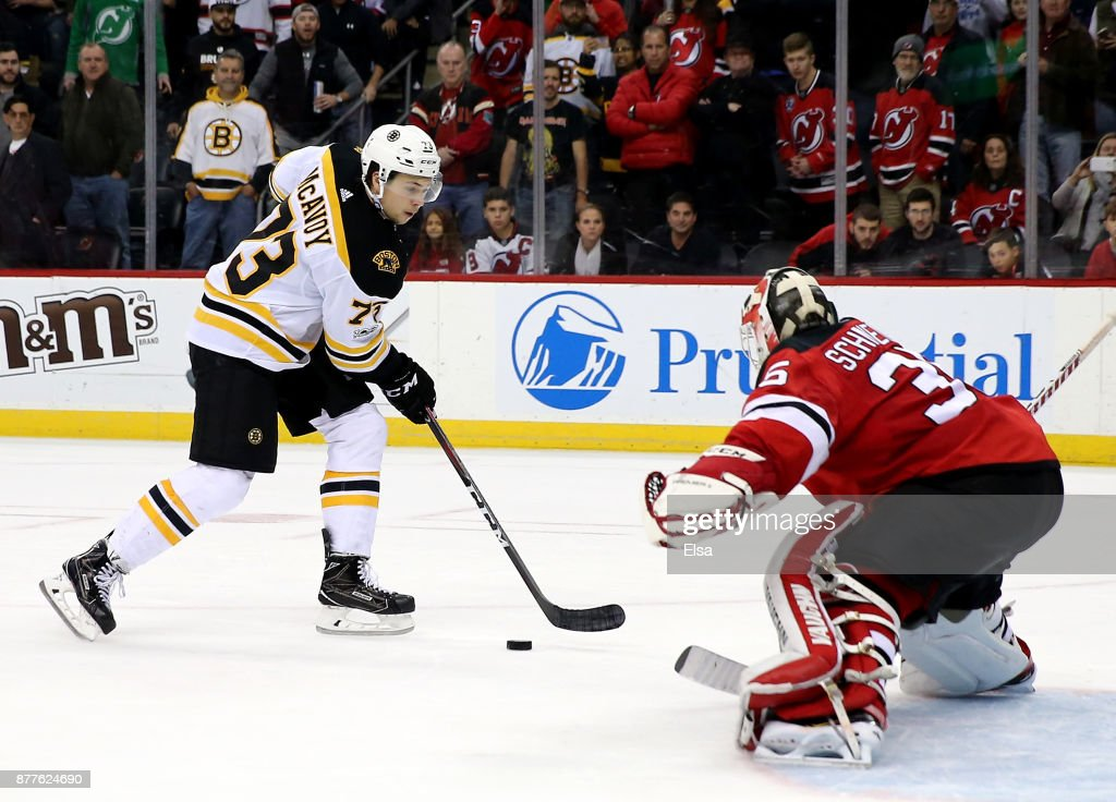 Charlie McAvoy #73 of the Boston Bruins scores the game winning goal in an overtime shootout against Cory Schneider #35 of the New Jersey Devils on November 22, 2017 at Prudential Center in Newark, New Jersey.The Boston Bruins defeated the New Jersey Devils 3-2 in an overtime shootout.