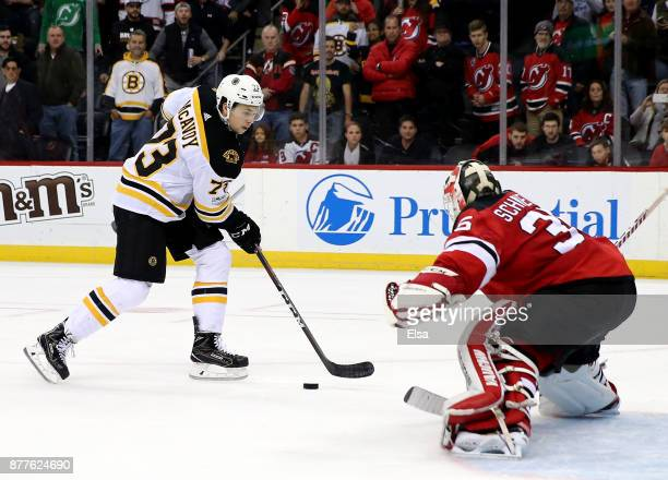 Charlie McAvoy of the Boston Bruins scores the game winning goal in an overtime shootout against Cory Schneider of the New Jersey Devils on November...