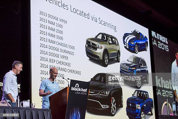 Charlie Miller security researcher for Twitter Inc and a former NSA hacker right speaks as Chris Valasek director of vehicle security research at the...