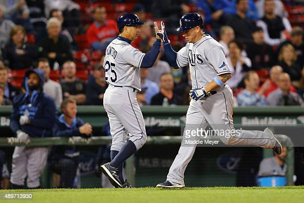 Charlie Montoyo of the Tampa Bay Rays congratulates Asdrubal Cabrera after he hit a home run against the Boston Red Sox during the ninth inning at...