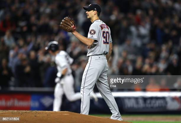 Charlie Morton of the Houston Astros reacts as Todd Frazier of the New York Yankees rounds the bases after a 3run home run during the second inning...