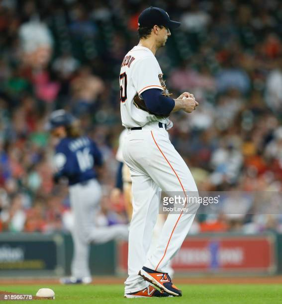 Charlie Morton of the Houston Astros rubs the ball as Ben Gamel of the Seattle Mariners rounds the bases after hitting a tworun home run in the...