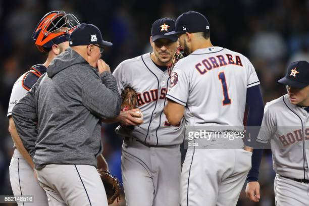 Charlie Morton of the Houston Astros speaks to teammates on the mound during the fourth inning against the New York Yankees in Game Three of the...