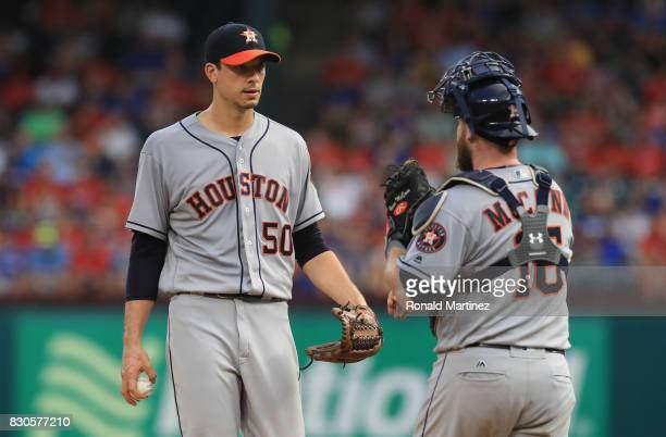 Charlie Morton of the Houston Astros talks with Brian McCann against the Texas Rangers in the third inning at Globe Life Park in Arlington on August...