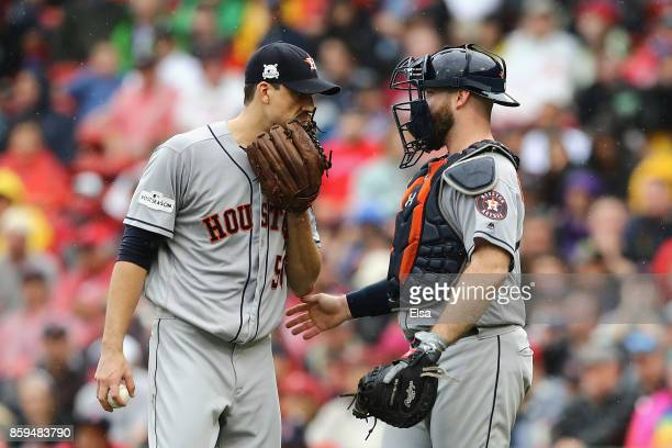 Charlie Morton talks with Brian McCann of the Houston Astros in the second inning against the Boston Red Sox during game four of the American League...