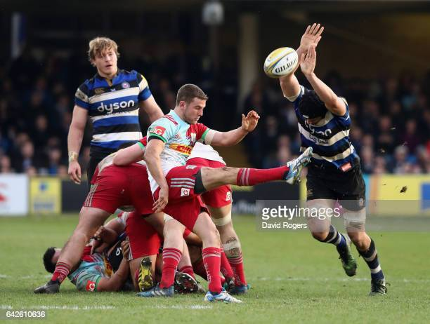 Charlie Mulchrone of Harlequins kicks the ball past Charlie Ewels during the Aviva Premiership match between Bath Rugby and Harlequins at the...