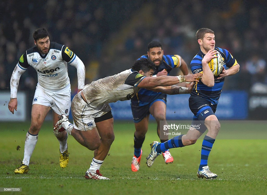Charlie Mulchrone of Worcester Warriors is tackled by <a gi-track='captionPersonalityLinkClicked' href=/galleries/search?phrase=Amanaki+Mafi&family=editorial&specificpeople=15024452 ng-click='$event.stopPropagation()'>Amanaki Mafi</a> of Bath Rugby during the Aviva Premiership match between Worcester Warriors and Bath Rugby at Sixways Stadium on February 13, 2016 in Worcester, England. (Photo by Tom Dulat/Getty Images).
