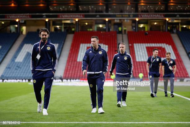 Charlie Mulgrew Callum McGregor and Leigh Griffiths of Scotland walk on the pitch prior to the FIFA 2018 World Cup Group F Qualifier between Scotland...