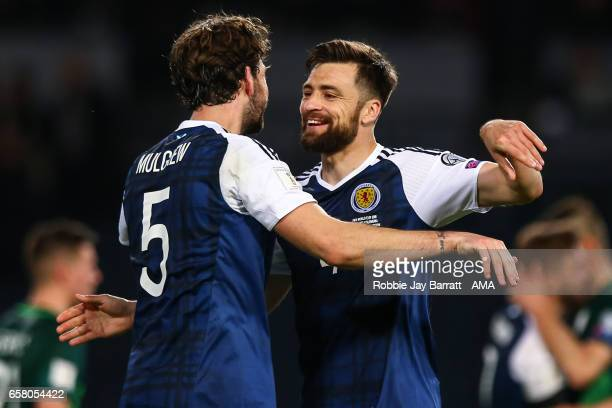 Charlie Mulgrew of Scotland and Russell Martin of Scotland celebrate at full time during the FIFA 2018 World Cup Qualifier between Scotland and...
