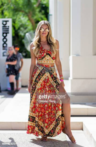 Charlie Neef wearing a a multi colour dress at the Revovle Festival during day 3 of the 2017 Coachella Valley Music Arts Festival Weekend 1 on April...
