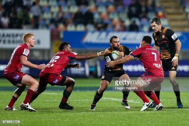 Charlie Ngatai of the Chiefs attempts to beat the defnce of Samu Kerevi and George Smith of the Reds during the round 11 Super Rugby match between...