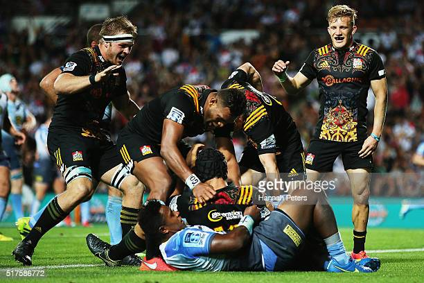 Charlie Ngatai of the Chiefs celebrates with Sam Cane of the Chiefs Seta Tamanivalu of the Chiefs and Damian McKenzie of the Chiefs after scoring a...