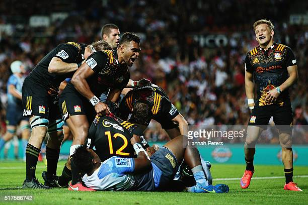 Charlie Ngatai of the Chiefs celebrates with Seta Tamanivalu of the Chiefs and his team after scoring a try during the round five Super Rugby match...