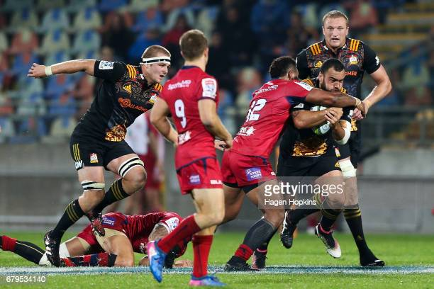 Charlie Ngatai of the Chiefs is tackled by Samu Kerevi of the Reds during the round 11 Super Rugby match between the Chiefs and the Reds at Yarrow...