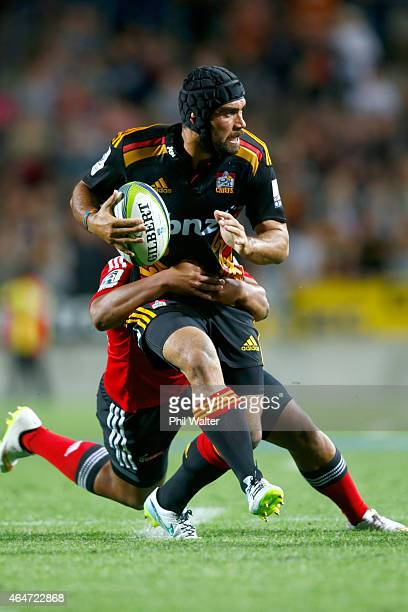 Charlie Ngatai of the Chiefs is tackled during the round three Super Rugby match between the Chiefs and the Crusaders at Waikato Stadium on February...