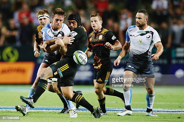 Charlie Ngatai of the Chiefs tackles Dane HaylettPetty of the Force during the round five Super Rugby match between the Chiefs and the Western Force...