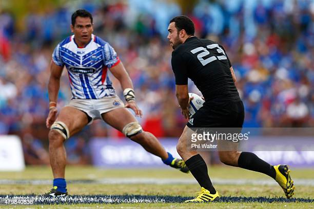 Charlie Ngatai of the New Zealand All Blacks passes the ball during the International Test match between Samoa and the New Zealand All Blacks at Apia...