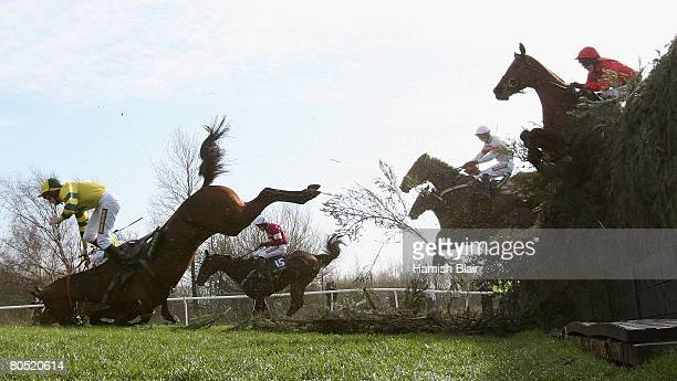 Charlie Poste falls from Marked Man as they come over Becher's Brook during The John Smith's Topham Steeple Chase during the Grand National Meeting...