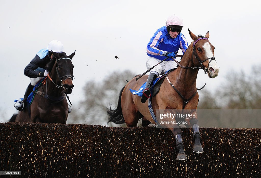 Charlie Poste rides Guns Of Love over the ditch during the TurfTV Handicap Steeple Chase run at Huntingdon Racecourse on January 14 2011 in...