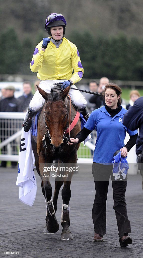 Charlie Poste riding Le Beau Bai celebrates after winning the Coral Welsh National at Chepstow racecourse on December 27, 2011 in Chepstow, Wales.