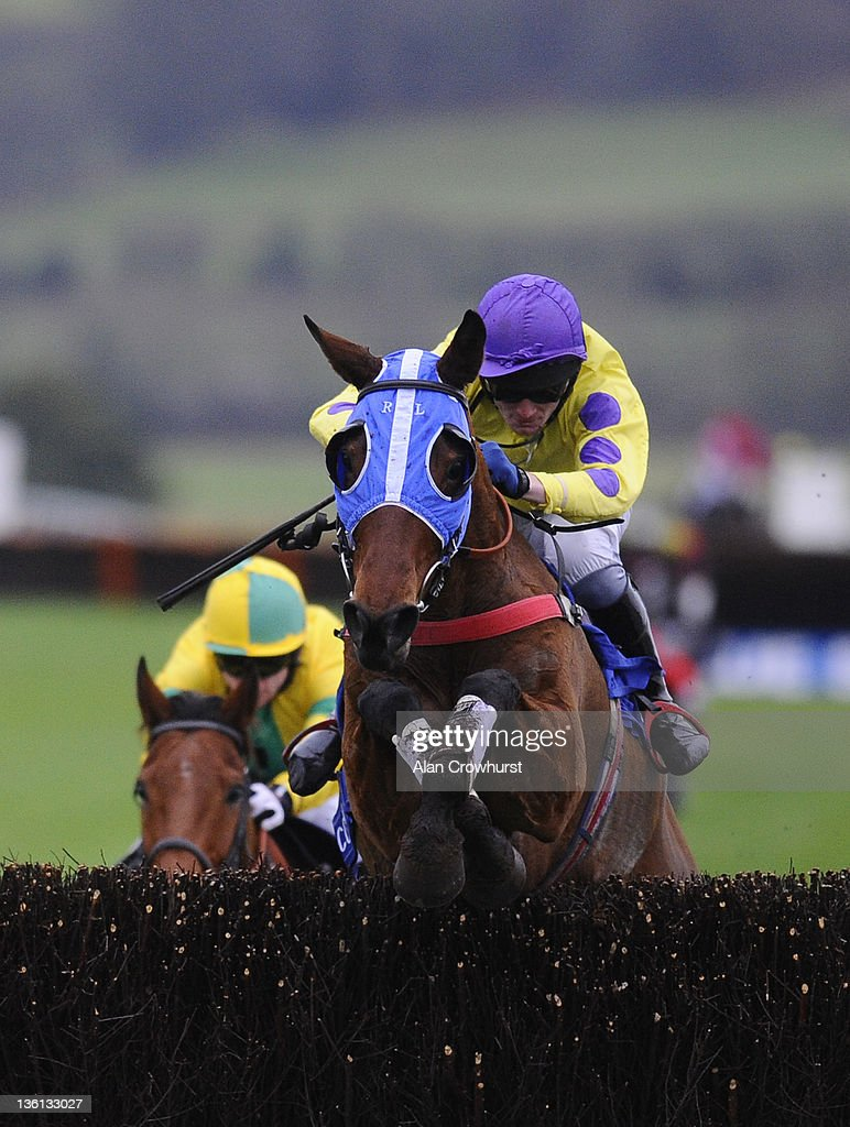 Charlie Poste riding Le Beau Bai clear the last to win the Coral Welsh National at Chepstow racecourse on December 27, 2011 in Chepstow, Wales.