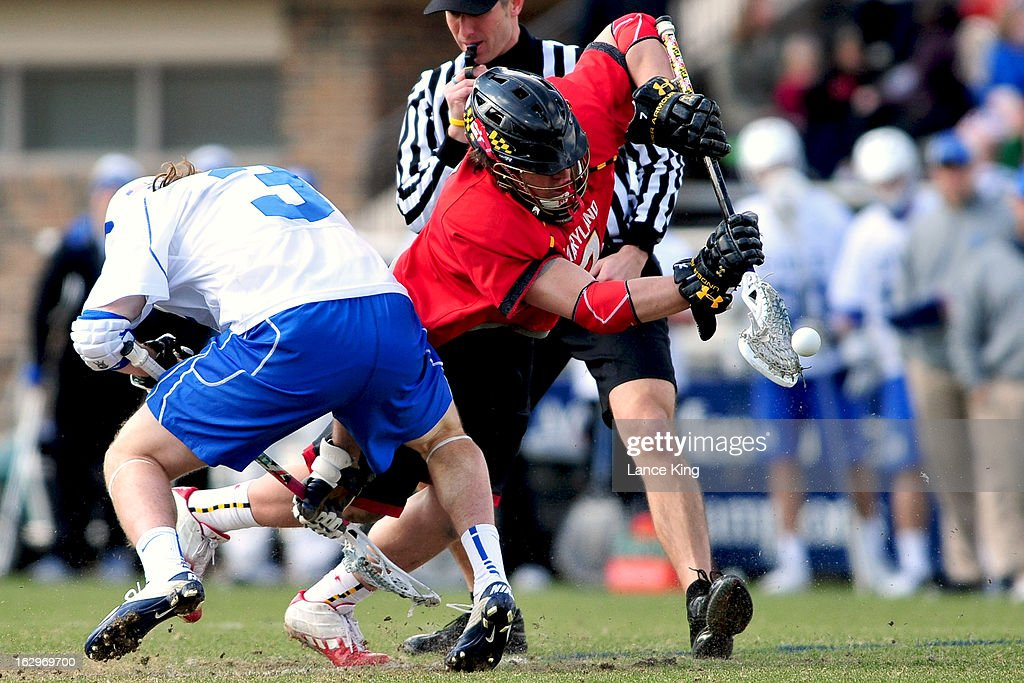 Charlie Raffa #7 of the Maryland Terrapins controls a face-off against Brendan Fowler #3 of the Duke Blue Devils at Koskinen Stadium on March 2, 2013 in Durham, North Carolina. Maryland defeated Duke 16-7.