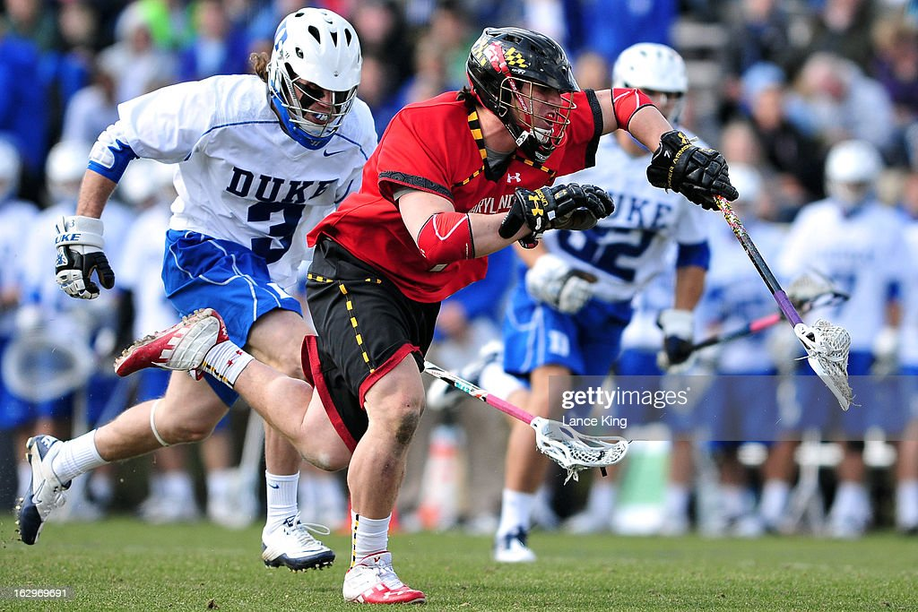 Charlie Raffa #7 of the Maryland Terrapins runs with the ball against Brendan Fowler #3 of the Duke Blue Devils at Koskinen Stadium on March 2, 2013 in Durham, North Carolina. Maryland defeated Duke 16-7.