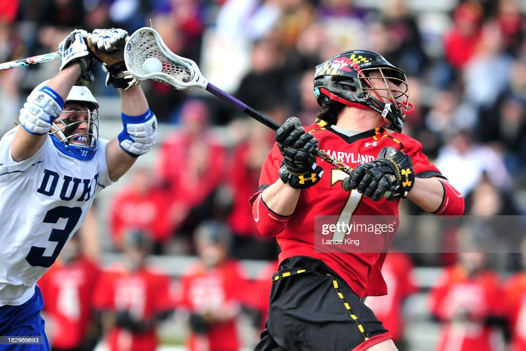 Charlie Raffa #7 of the Maryland Terrapins shoots the ball against Brendan Fowler #3 of the Duke Blue Devils at Koskinen Stadium on March 2, 2013 in Durham, North Carolina. Maryland defeated Duke 16-7.