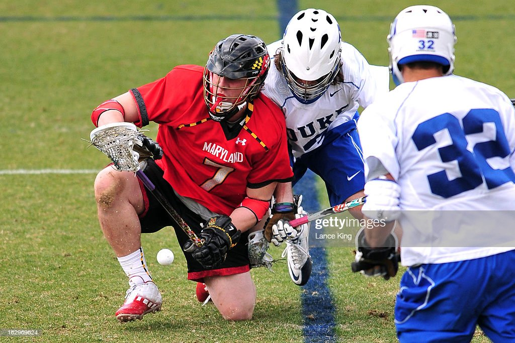 Charlie Raffa #7 of the Maryland Terrapins tries to control the ball during a face-off against Brendan Fowler #3 of the Duke Blue Devils at Koskinen Stadium on March 2, 2013 in Durham, North Carolina. Maryland defeated Duke 16-7.