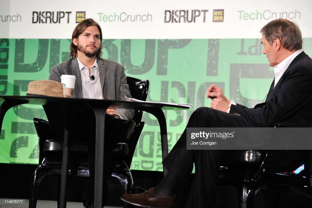 Charlie Rose and Ashton Kutcher share a conversation during the TechCrunch Disrupt New York May 2011 at Pier 94 on May 24 2011 in New York City