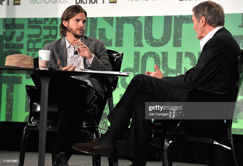 Charlie Rose and Ashton Kutcher (R) share a conversation during the TechCrunch Disrupt New York May 2011 at Pier 94 on May 24, 2011 in New York City.