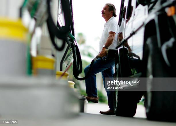 Charlie Sanchez fills his tank at a gas station July 18 2006 in Miami Florida Across the country the average price of regular unleaded gasoline is...