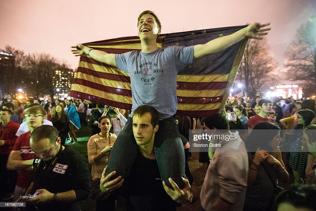Charlie Schumacher, 21, of Boston University, sat on the shoulders of Troy Astorino, 22, of MIT, during a celebration in the Boston Common after both marathon bombing suspects were found. After an intense manhunt and two-hour standoff in Watertown, law enforcement took a person into custody believed to be related to the Boston Marathon bombings.