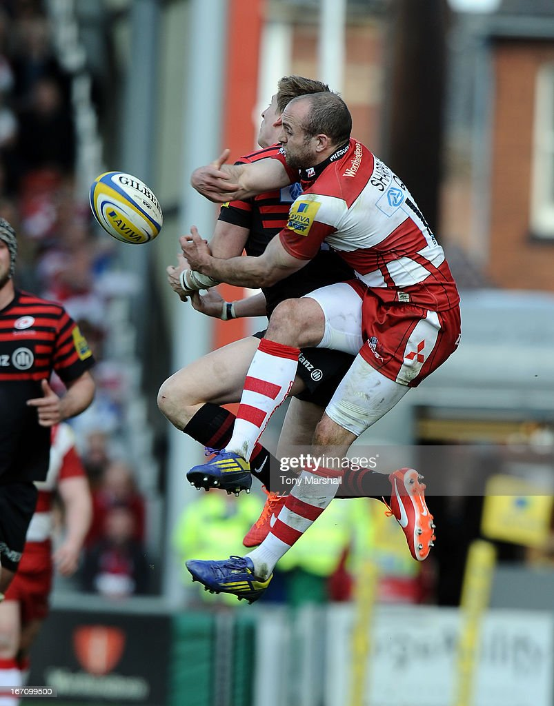 Charlie Sharlpes of Gloucester clashes with Chris Wyles of Saracens during the Aviva Premiership match between Gloucester and Saracens at Kingsholm Stadium on April 20, 2013 in Gloucester, England.