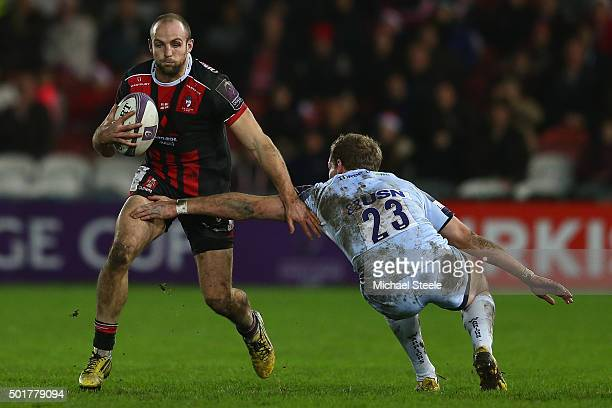 Charlie Sharples of Gloucester sidesteps the challenge of Max Stelling of Worcester during the European Rugby Challenge Cup Round Four match between...