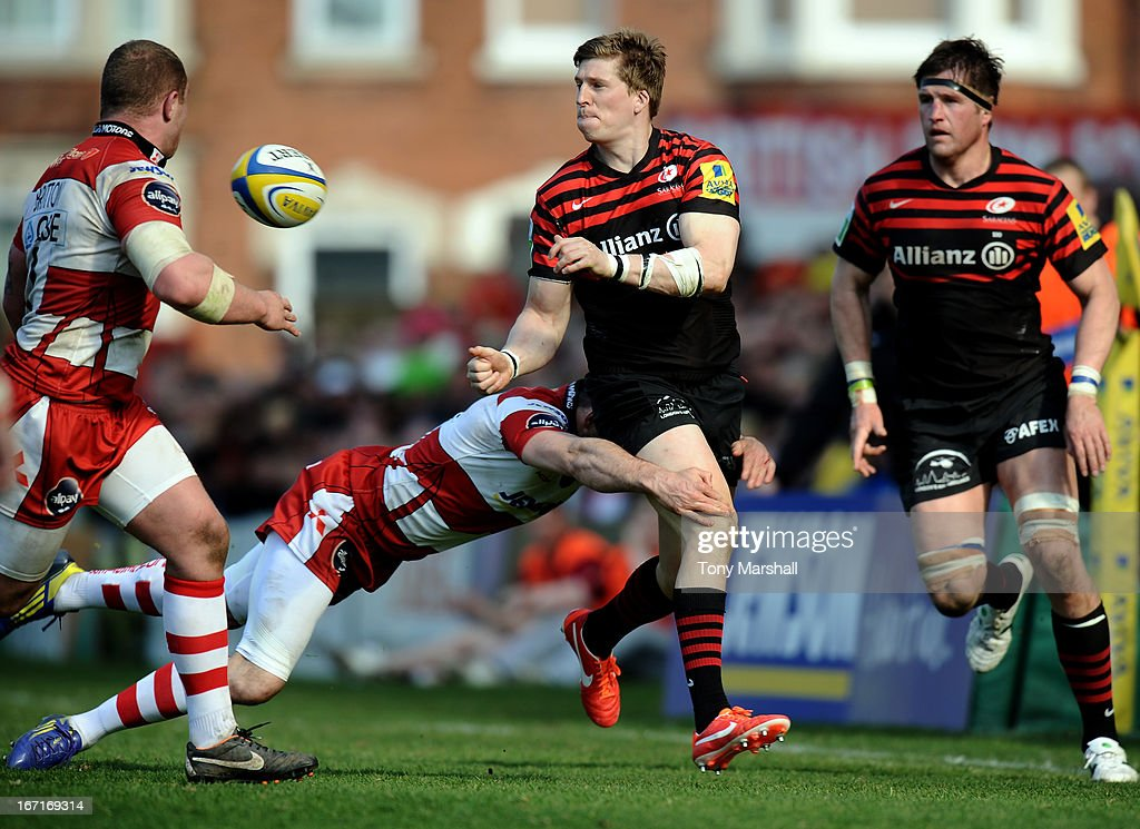 Charlie Sharples of Gloucester tackles David Strettle of Saracens during the Aviva Premiership match between Gloucester and Saracens at Kingsholm Stadium on April 20, 2013 in Gloucester, England.