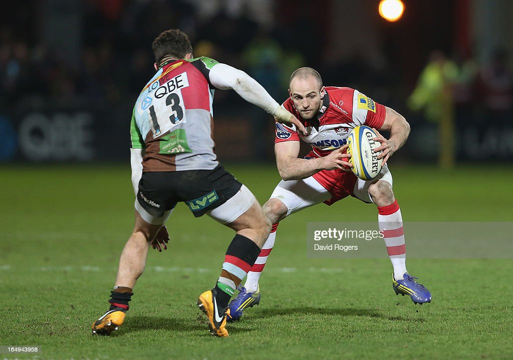 <a gi-track='captionPersonalityLinkClicked' href=/galleries/search?phrase=Charlie+Sharples&family=editorial&specificpeople=842647 ng-click='$event.stopPropagation()'>Charlie Sharples</a> of Gloucester takes on George Lowe during the Aviva Premiership match between Gloucester and Harlequins at Kingsholm Stadium on March 29, 2013 in Gloucester, England.