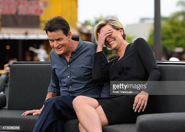 Charlie Sheen and Charissa Thompson visit 'Extra' at Universal Studios Hollywood on May 12 2015 in Universal City California