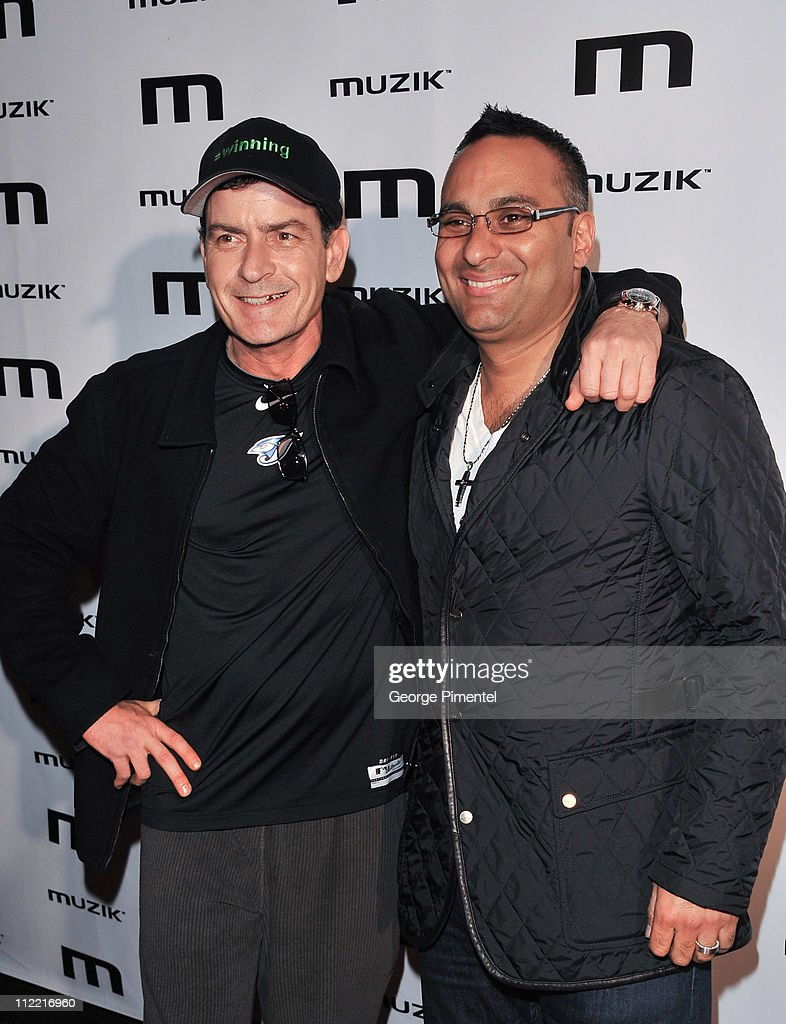 <a gi-track='captionPersonalityLinkClicked' href=/galleries/search?phrase=Charlie+Sheen&family=editorial&specificpeople=206152 ng-click='$event.stopPropagation()'>Charlie Sheen</a> and Russell Peters attends the official after-party for his 'Torpedo of Truth' tour at Muzik on April 14, 2011 in Toronto, Canada.