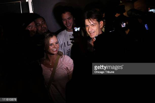 Charlie Sheen arrives at Enclave nightclub after an appearance at the Chicago Theater in Chicago Illinois April 3 2011