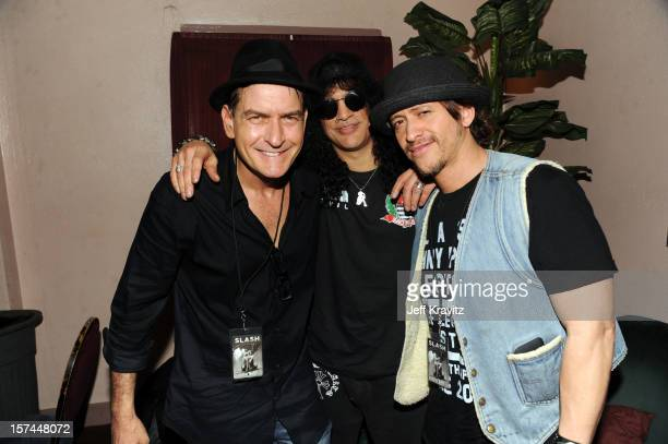 Charlie Sheen Slash and Clifton Collins backstage at Slash featuring Myles Kennedy and the Conspirators at the Wiltern Theater on December 2 2012 in...